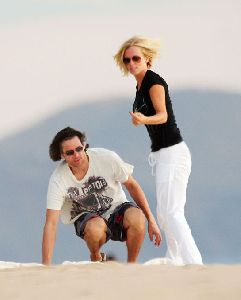 Model Jenny McCarthy pic with Jim Carrey watching the sun set in a romantic atmosphere