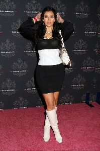 Sexy Kim Kardashian see through dress pictures at a Mobile Phone Sidekick LX Party on October 18th 2007