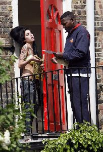 Amy Winehouse pictures answering her door in a bra
