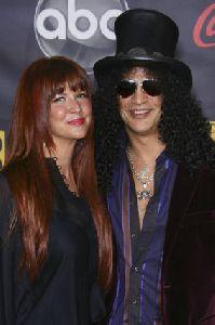 Perla Ferrar and Slash pictures at 2007 American Music Awards