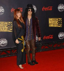 Perla Ferrar and Slash pictures at 2007 American Music Awards
