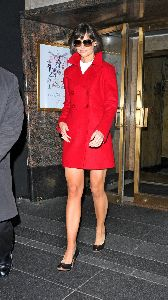 Katie Holmes : Katie Holmes shows legs as she leaves her hotel-03 478c847349c63