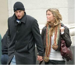Brooklyn Decker and andy roddick walking hand in hand