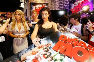 Kim Kardashian and Carmen Electra At Diaster Movie Talent Signing at Comic Con on July 26th, 2007