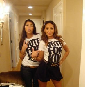 adrienne bailon and Kourtney kardashian wearing Vote For Kim tshirts on September 14th 2008 for dancing with the stars TEAM KARDASHIAN campaign