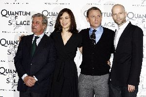 Olga Kurylenko : Olga Kurylenko with the director Marc Forster and co-star daniel Craig at Quantum of Solace photocall in Rome