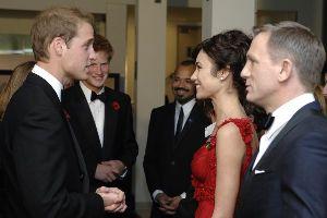 Olga Kurylenko : Olga Kurylenko with Daniel Craig and Prince William Windsor