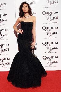 Olga Kurylenko : Olga Kurylenko wearing an elegant black cocktail dress for the Quantum of Solace premiere in Rome