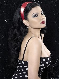 Haifa Wehbe : black and white dress with a full red lipstick just like the 70 s fashion trend