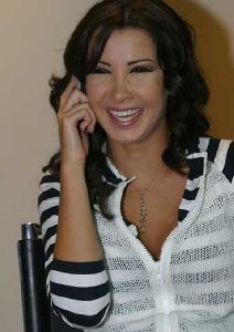 Nancy Ajram : nancy talking on her cellphone while on a magazine interview