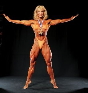 Cory Everson : Corey Everson wearing a medal as her bodybuilding award