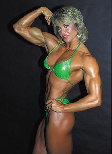 Cory Everson : an old photo of the well-built arm muscles of Cory Everson