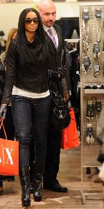 Ciara : Ciara followed by her bodyguard as she shops at a French Connection clothing store on December 11, 2008 in New York City