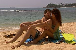 Kivanc Tatlitug : with Songul Oden together on the beach wearing swimming suits