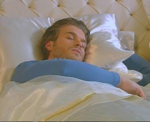 Kivanc Tatlitug : sleeping on the white bed of Gumus Drama Tv series - Noor