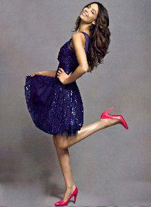 Azra Akin : large poster wearing a stylish purple dres