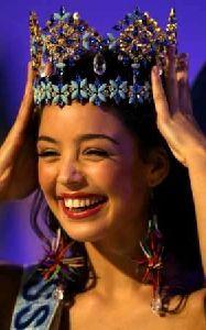 Azra Akin wearing the gem shiny crown of Miss world 2002