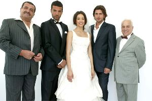 Azra Akin picture with other actors where she is wearing a wedding dress