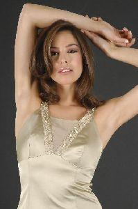 Azra Akin light brown straight hair wearing a light beige top