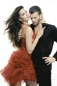 Azra Akin in a stylish red dress hugging her boyfriend Kivanc Tatlitug