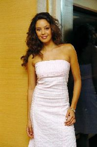 Azra Akin in a stylish backless long white dress