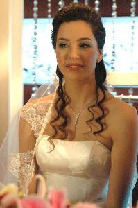 Azra Akin as a beautiful bride in a wedding dress