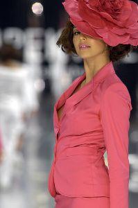 Azra Akin wearing a large pink flower hat