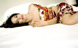 Azra Akin sleeping on a white shawl
