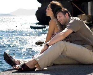 Azra Akin on the beach hugged by her boyfriend Kivanc Tatlitug