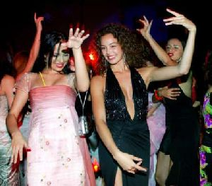 Azra Akin dancing at the pre-announcement party of 2002 miss world