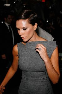 VICTORIA BECKHAM : arriving at the Launch  Signature  in newyork city wearing a extra-large diamond stone ring