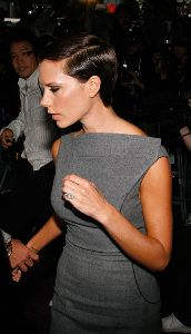 VICTORIA BECKHAM : at the Launch  Signature  in newyork city wearing a large diamond stone wedding ring