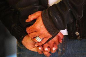 VICTORIA BECKHAM : With David Beckham at British Formula 1 Grand Prix hand in hand - David s diamond stones ring