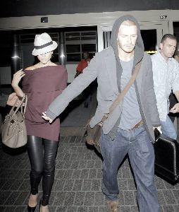 VICTORIA BECKHAM : and David Beckham land at the Bradley International Terminal of Los Angeles International Airport, both looking tired after taking a British Airways flight from London - Copy