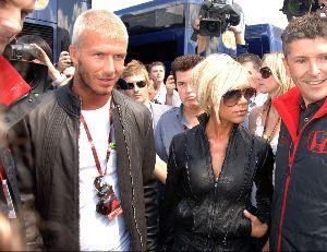 VICTORIA BECKHAM : with husband David Beckham at the British Formula 1 Grand Prix