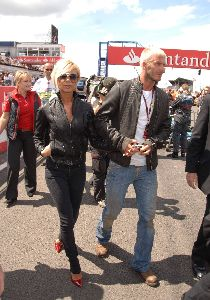 VICTORIA BECKHAM : holding hands with David at the british formula 1 Grand Prix