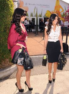 Kourtney Kardashian : with sister Kim attend the Spring 2009 Mercedes-Benz Fashion Week held at Smashbox Studios on October 14, 2008