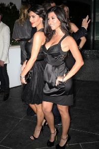 Kourtney Kardashian : with sister Kim at the the Grand Opening Ceremony of The Fontainebleau Hotel On South Beach