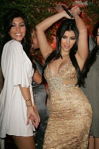 Kourtney Kardashian : with Kim who is dancing at her at her  Birthday Party At Les Deux on October 21, 2007 in Los Angeles, California