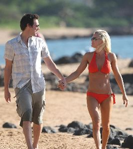 Jenny McCarthy : spotted wearing an orange bikini and walking on Hawaii Beach together with Jim Carrey on the 5th, Jan 2009