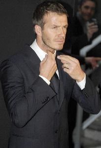 David Beckham arrives at the Emporio Armani Menswear fashion show in Milan, Italy on Sunday