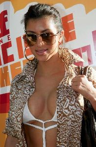Kim Kardashian : wearing a weird outfit - a cotton unbuttoned shirt over a white bra tied backwards at the Stuff Magazine Pool Party on September 19th 2007