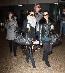 Kim Kardashian : and Kourtney Kardashian arriving at Salt Lake City Airport for the 2009 Sundance Film Festival, in Utah on the 17th of January 2009