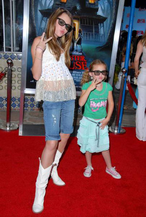 Vote for this picture Miley Cyrus and Noah arrive at Monster House Los