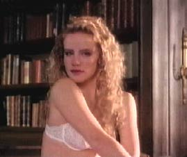 Amanda Peterson wearing a white...