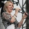 Liz Phair recent picture singing at an outdoor concert